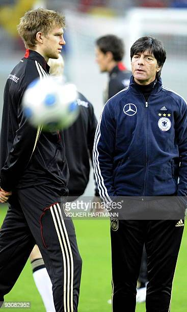 Germany's football team head coach Joachim Loew and Germany's defender Per Mertesacker talk during a training session on November 16 2009 in...