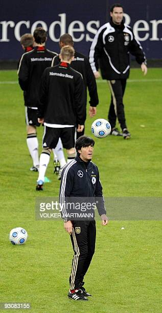 Germany's football team head coach Joachim Loew prepares to head the ball during a training session on November 16 2009 in Duesseldorf western...