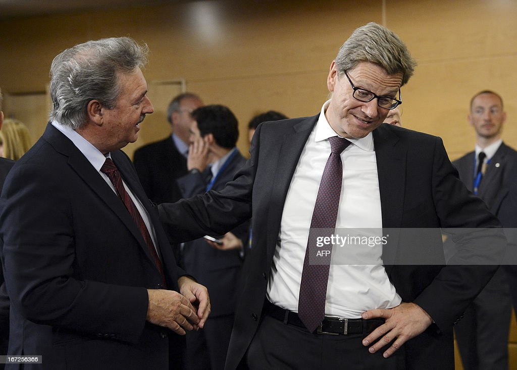 Germany's Foreign Affairs Minister Guido Westerwelle (R) shares a few words with Luxembourg's Foreign Affairs Minister Jean Asselborn during a NATO Foreign Affairs Ministers meeting at NATO headquarter in Brussels on April 23, 2013. AFP Photo/Thierry Charlier