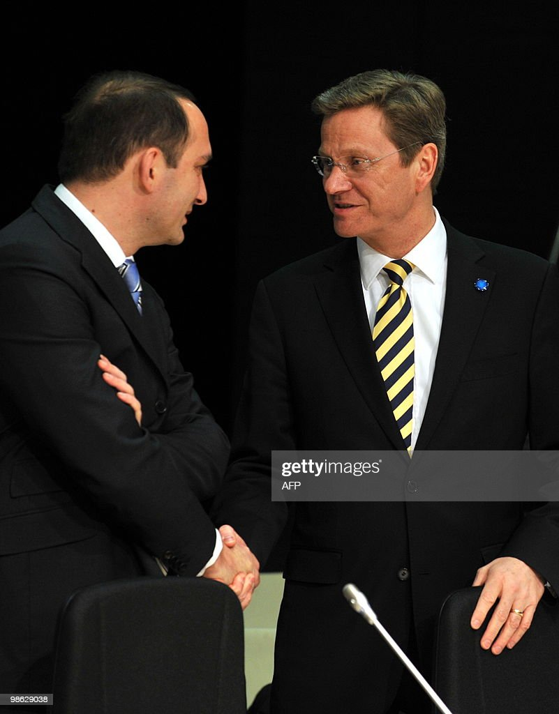 Germany's Foreign Minister Guido Westerwelle (R) speaks with Head of Mission of Georgia Grigol Mgaloblishvili at the beginning of the North Atlantic Council meeting with Non-NATO ISAF contributors during the informal NATO Foreign Ministers meeting in Tallinn on April 23, 2010. NATO foreign ministers met Friday to iron out a plan for international troops and civilian staff in Afghanistan to hand over responsibility to the local military and government.