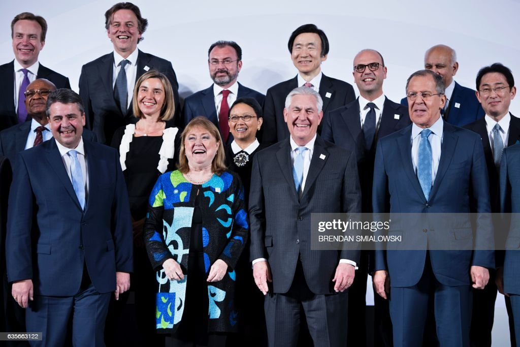 Germany's Foreign Minister Sigmar Gabriel, Argentina's Foreign Minister Susana Malcorra, US Secretary of State Rex Tillerson and Russia's Foreign Minister Sergey Lavrov pose with others for a group photo of G-20 foreign ministers during a meeting at the World Conference Center February 16, 2017 in Bonn, Germany. US Secretary of State Rex Tillerson makes his diplomatic debut at a G20 gathering in Germany on February 16, 2017 where his counterparts hope to find out what 'America First' means for the rest of the world. / AFP / Brendan Smialowski