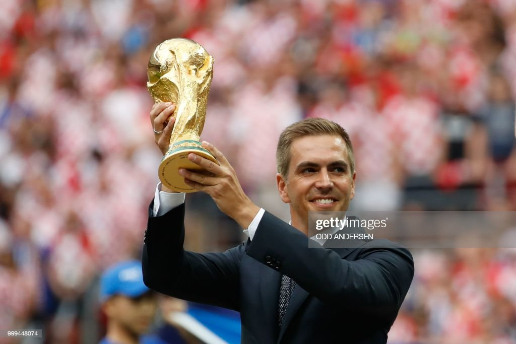 Germany's former captain Philipp Lahm poses with the trophy during the closing ceremony prior to the Russia 2018 World Cup final football match between France and Croatia at the Luzhniki Stadium in Moscow on July 15, 2018. (Photo by Odd ANDERSEN / AFP) / RESTRICTED