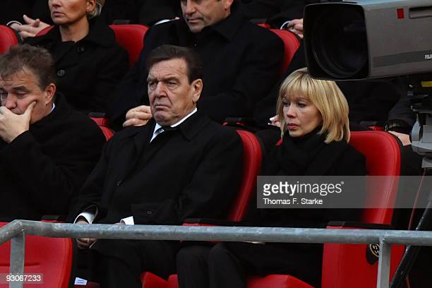Germany's former Chancellor Gerhard Schroeder and his wife Doris SchroederKoepf attend the memorial service prior to Robert Enke's funeral at AWD...