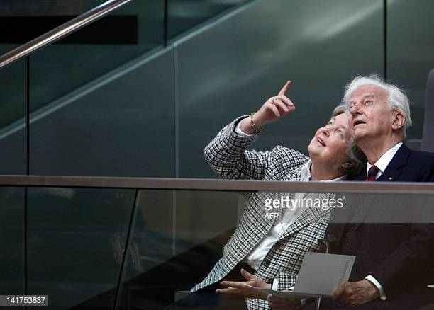 Germany's former state president Richard von Weizsaecker and his wife Marianne von Weizsaecker look up at the Bundestags Dome during the swearingin...