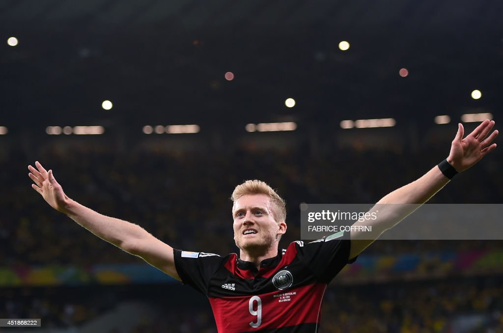 Germany's forward Andre Schuerrle celebrates after scoring a goal during the semi-final football match between Brazil and Germany at The Mineirao Stadium in Belo Horizonte during the 2014 FIFA World Cup on July 8, 2014. AFP PHOTO / FABRICE COFFRINI / AFP PHOTO / Fabrice COFFRINI