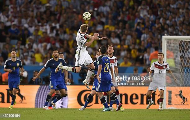 Germany's forward Andre Schuerrle heads the ball during the second half of extratime during the 2014 FIFA World Cup final football match between...