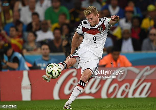 Germany's forward Andre Schuerrle kicks the ball during the 2014 FIFA World Cup final football match between Germany and Argentina at the Maracana...