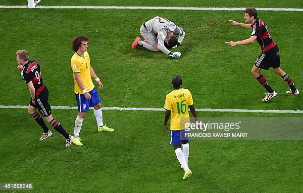 Germany's forward Andre Schuerrle scores past Brazil's goalkeeper Julio Cesar during the semifinal football match between Brazil and Germany at The...