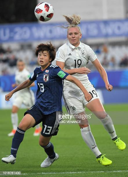 Germany's forward Annalena Rieke vies with Japan's midfielder Asato Miyagawa during the Women's World Cup U20 quarter final football match between...