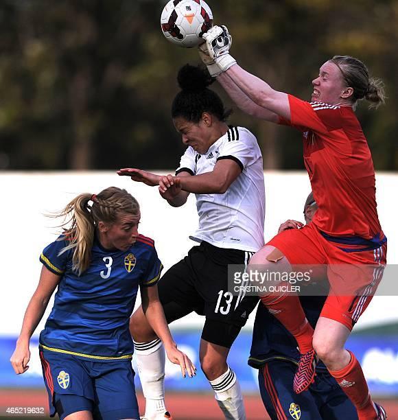 Germany's forward Celia Sasic vies with Sweden's goalkeeper Hedvig Lindahl and Sweden's defender Linda Sembrant during the match Germany vs Sweden at...