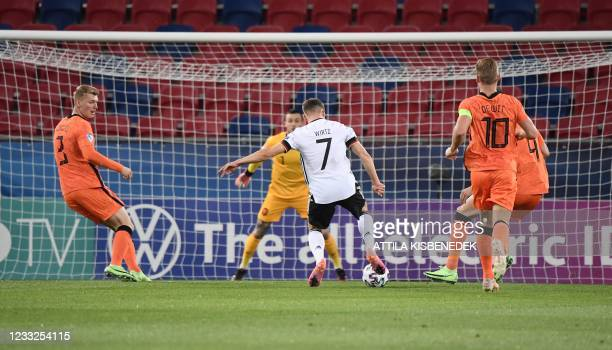 Germany's forward Florian Wirtz scores the second goal for his team during the UEFA Under21 Championship semi final football match between the...