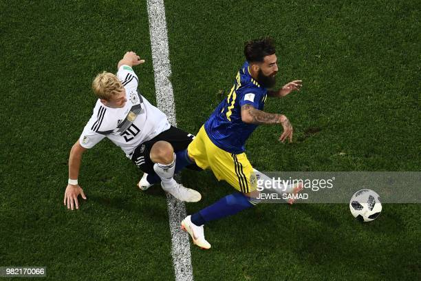 Germany's forward Julian Brandt vies for the ball with Sweden's midfielder Jimmy Durmaz during the Russia 2018 World Cup Group F football match...