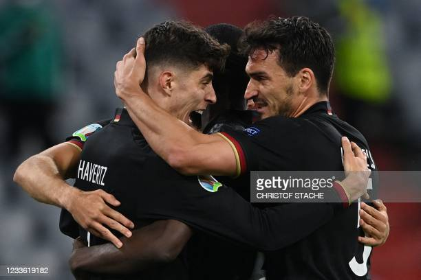 Germany's forward Kai Havertz celebrates with Germany's defender Mats Hummels after scoring their first goal during the UEFA EURO 2020 Group F...