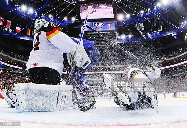 Germany's forward Kai Hospelt falls next to his goalkeeper Dennis Endras during the group A preliminary round match France vs Germany at the 2015...