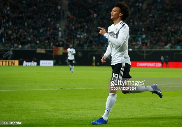 Germany's forward Leroy Sane celebrates scoring the opening goal during international friendly football match Germany v Russia in Leipzig eastern...