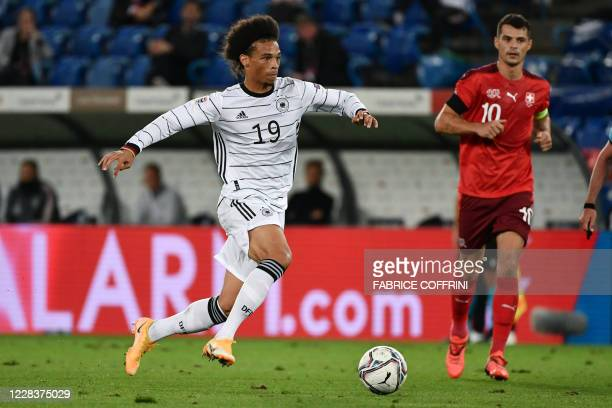 Germany's forward Leroy Sane fights for the ball with Switzerland's midfielder Granit Xhaka during the UEFA Nations League, league A, day 2, group 4...