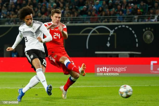 Germany's forward Leroy Sane scores the opening goal next to Russia's midfielder Kirill Nababkin during international friendly football match Germany...