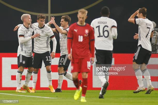 Germany's forward Luca Waldschmidt celebrates scoring the opening goal with his teammates during the international friendly football match Germany v...