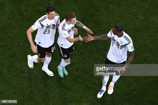 Germany's forward Marco Reus celebrates his goal with Germany's defender Jerome Boateng during the Russia 2018 World Cup Group F football match...