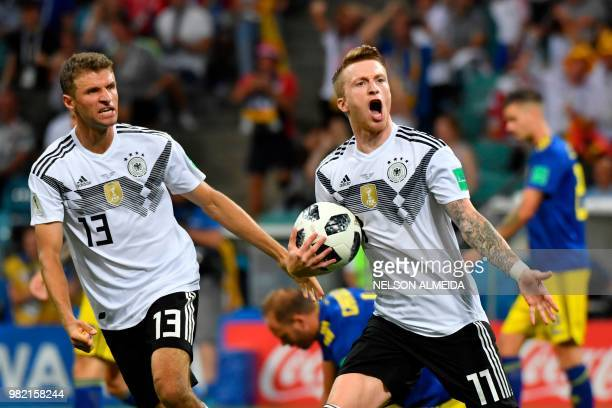 TOPSHOT Germany's forward Marco Reus celebrates scoring the 11 goal with Germany's forward Thomas Mueller during the Russia 2018 World Cup Group F...