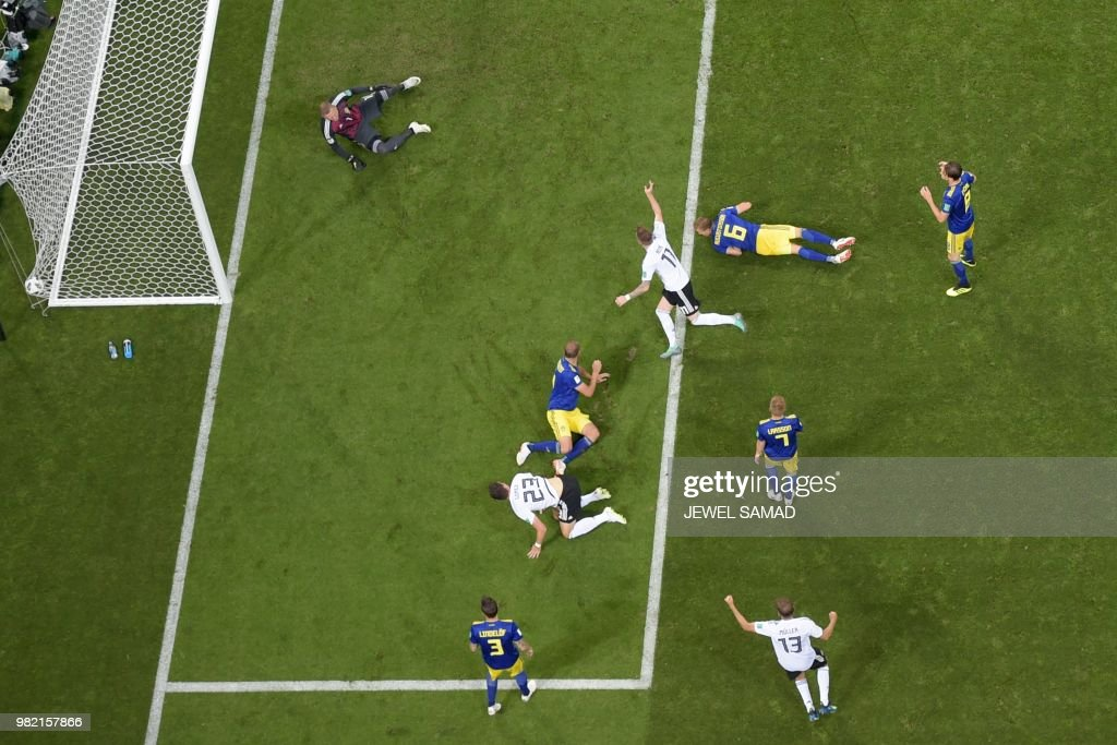 TOPSHOT - Germany's forward Marco Reus (C, #11) scores his teams equalising goal during the Russia 2018 World Cup Group F football match between Germany and Sweden at the Fisht Stadium in Sochi on June 23, 2018. (Photo by Jewel SAMAD / AFP) / RESTRICTED