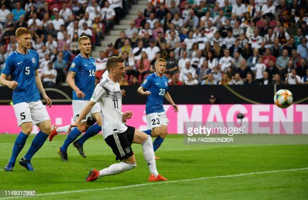 Germany's forward Marco Reus scores the opening goal during the UEFA Euro 2020 qualifier Group C football match Germany against Estonia on June 11...