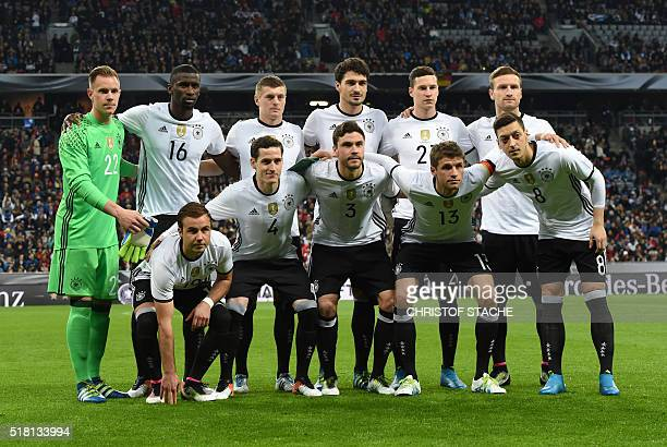 Germany's forward Mario Goetze Germany's midfielder Sebastian Rudy Germany's defender Jonas Hector Germany's midfielder Thomas Mueller and Germany's...