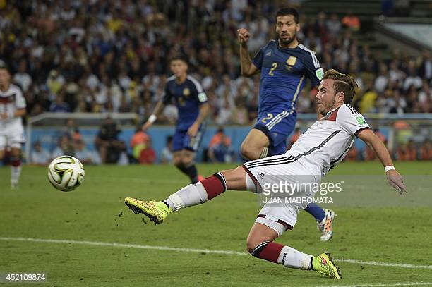 Germany's forward Mario Goetze scores his team's first goal during extra time of the 2014 FIFA World Cup final football match between Germany and...
