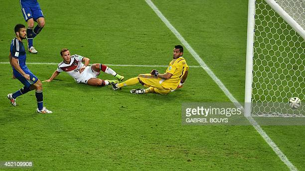 Germany's forward Mario Goetze shoots and scores past Argentina's goalkeeper Sergio Romero during the 2014 FIFA World Cup final football match...