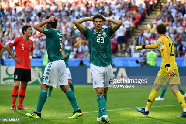 TOPSHOT Germany's forward Mario Gomez and Germany's defender Mats Hummels react after failing to score during the Russia 2018 World Cup Group F...