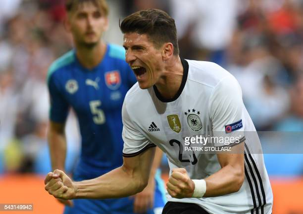 Germany's forward Mario Gomez celebrates after scoring a goal during the Euro 2016 round of 16 football match between Germany and Slovakia at the...