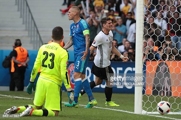 Germany's forward Mario Gomez celebrates after scoring his team's second goal during the Euro 2016 round of 16 football match between Germany and...