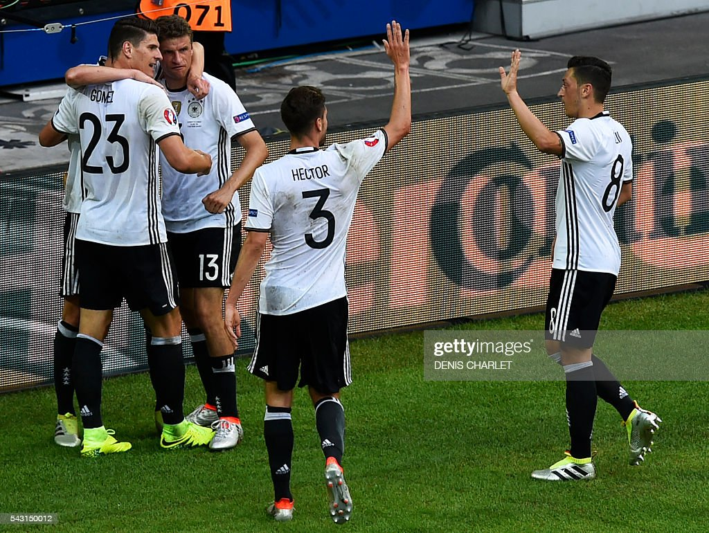 Germany's forward Mario Gomez (L) celebrates with teammates after scoring during the Euro 2016 round of 16 football match between Germany and Slovakia at the Pierre-Mauroy stadium in Villeneuve-d'Ascq, near Lille, on June 26, 2016. / AFP / DENIS