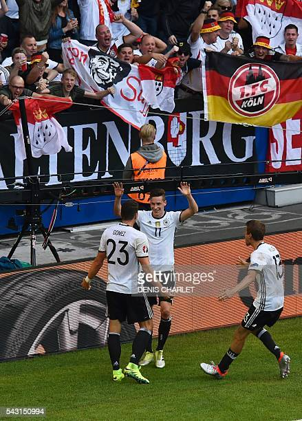 Germany's forward Mario Gomez celebrates with teammates after scoring during the Euro 2016 round of 16 football match between Germany and Slovakia at...