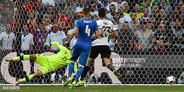 Germany's forward Mario Gomez scores against Slovakia's goalkeeper Matus Kozacik during the Euro 2016 round of 16 football match between Germany and...