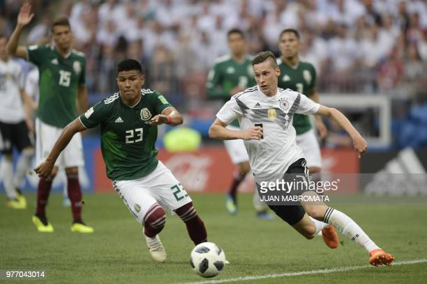 Germany's forward Mario Gomez vies for the ball with Germany's forward Julian Draxler during the Russia 2018 World Cup Group F football match between...