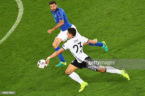 Germany's forward Mario Gomez vies for the ball with Italy's defender Andrea Barzagli during the Euro 2016 quarterfinal football match between...