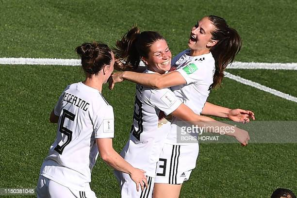 Germany's forward Melanie Leupolz celebrates with teammates after scoring a goal during the France 2019 Women's World Cup Group B football match...