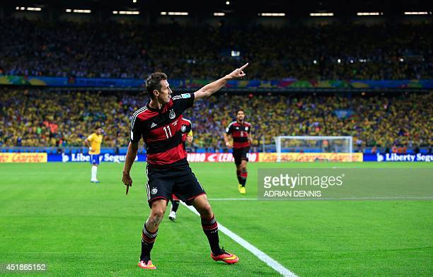 Germany's forward Miroslav Klose celebrates after scoring during the semi-final football match between Brazil and Germany at The Mineirao Stadium in...