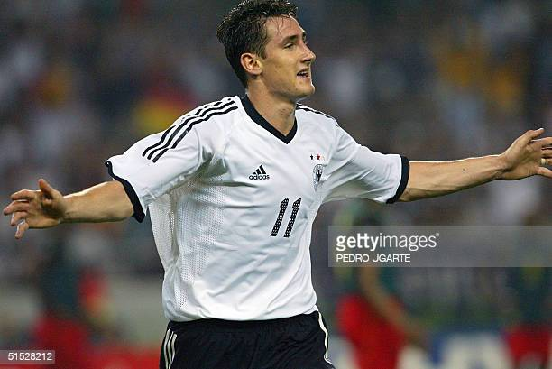 Germany's forward Miroslav Klose celebrates after scoring the second goal against Germany during match 35 group E of the 2002 FIFA World Cup Korea...