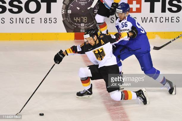 Germany's forward Patrick Hager and Slovakia's forward Marko Dano vie during the IIHF Men's Ice Hockey World Championships Group A match between...
