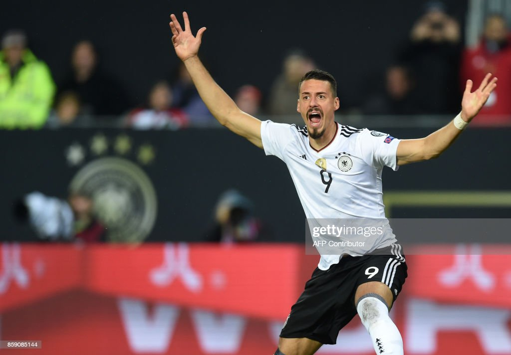 Germany's forward Sandro Wagner celebrates scoring during the FIFA World Cup 2018 qualification football match between Germany and Azerbaijan in Mainz, western Germany, on October 8, 2017. / AFP PHOTO / Christof STACHE