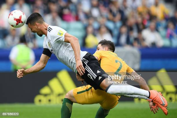 TOPSHOT Germany's forward Sandro Wagner heads the ball past Australia's defender Milos Degenek during the 2017 Confederations Cup group B football...