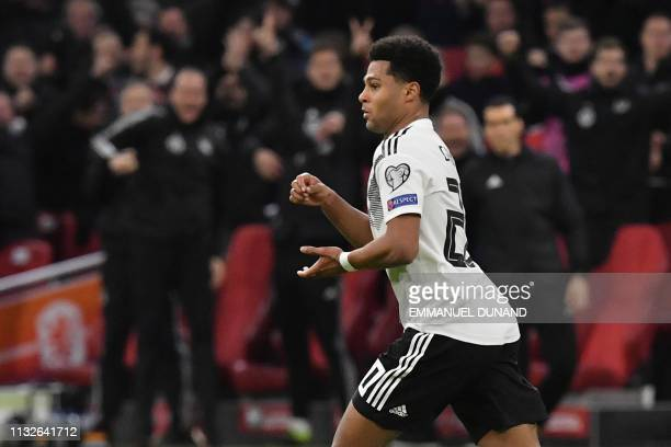 Germany's forward Serge Gnabry celebrates after scoring their second goal during the UEFA Euro 2020 Group C qualification football match between The...