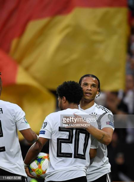 Germany's forward Serge Gnabry celebrates scoring the 20 goal with his teammate midfielder Leroy Sane during the UEFA Euro 2020 qualifier Group C...
