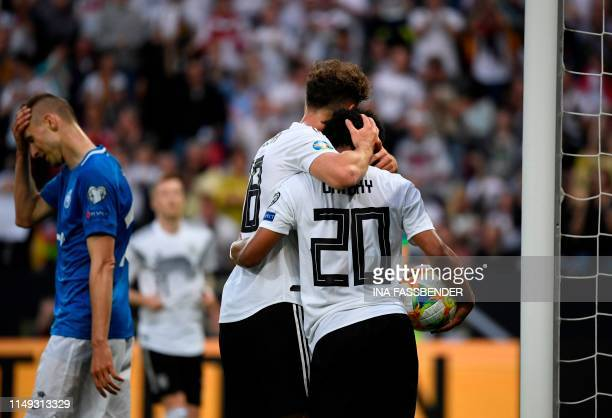Germany's forward Serge Gnabry celebrates scoring the 20 goal with his teammate midfielder Leon Goretzka during the UEFA Euro 2020 qualifier Group C...
