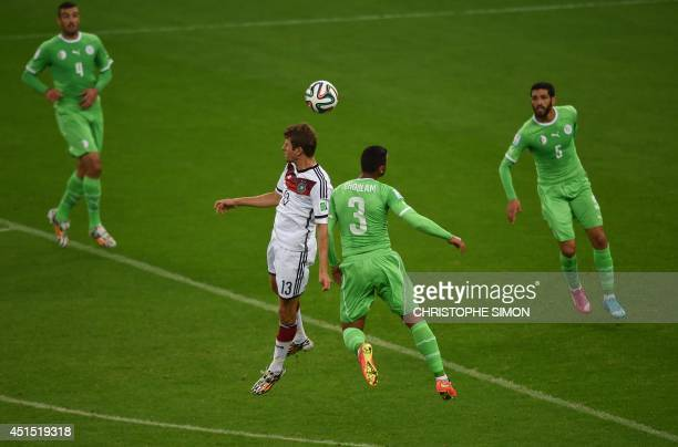 Germany's forward Thomas Mueller and Algeria's defender Faouzi Ghoulam vie during the Round of 16 football match between Germany and Algeria at...