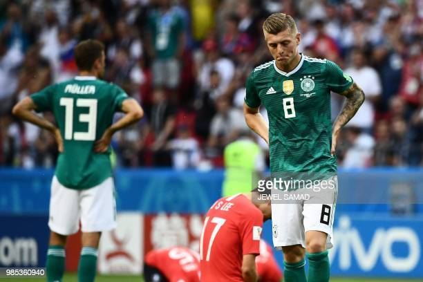 Germany's forward Thomas Mueller and Germany's midfielder Toni Kroos react after South Korea's forward Son Heungmin scored the second goal during the...