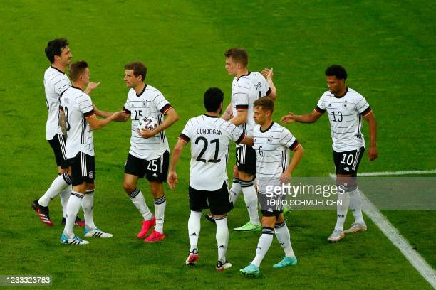 Germany's forward Thomas Mueller celebrates scoring the 3-0 goal with teammates during the friendly football match between Germany and Latvia in...