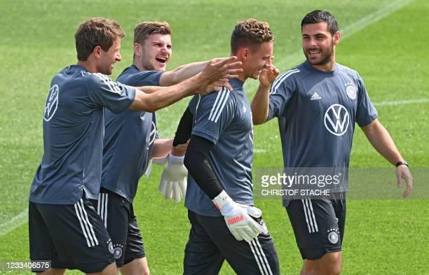 Germany's forward Thomas Mueller, Germany's forward Timo Werner, Germany's goalkeeper Bernd Leno and Germany's forward Kevin Volland joke around...